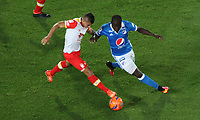 BOGOTA -COLOMBIA, 19-03-2017. Eliser Quinonez (R) player of Millonarios  fights for the ball with Juan Roa (L) player of Independiente Santa Fe  during match for the date 10 of the Aguila League I 2017 played at Nemesio Camacho El Campin stadium . Photo:VizzorImage / Felipe Caicedo  / Staff
