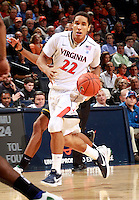 CHARLOTTESVILLE, VA- DECEMBER 6: Malcolm Brogdon #22 of the Virginia Cavaliers handles the ball during the game on December 6, 2011 against the George Mason Patriots at the John Paul Jones Arena in Charlottesville, Virginia. Virginia defeated George Mason 68-48. (Photo by Andrew Shurtleff/Getty Images) *** Local Caption *** Malcolm Brogdon