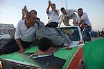 KIRKUK, IRAQ:  An Iraqi Kurd kisses an image of Jalal Talabani, the head of the Patriotic Union of Kurdistan (PUK) and president if Iraq...On March 7th, 2010 Iraq held national parliamentary elections...Photo by Hawre Khalid/Metrography