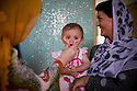 MP Ms. Fawzia Koofi plays with a child in between meetings held in her family home in Faizabad. Badakshan, Afghanistan, 2012