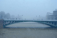 Paris bridge in the snow - Photograph by Owen Franken