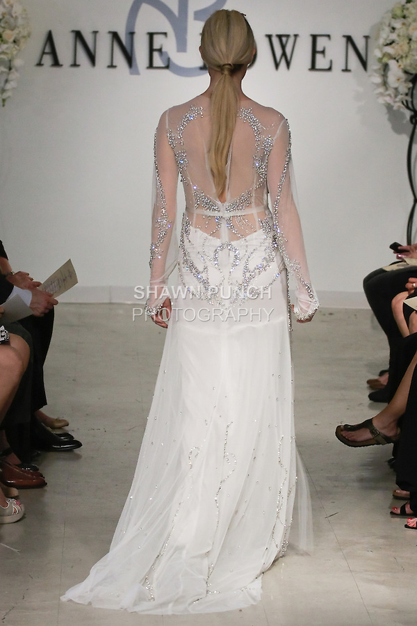 Model walks runway in a St. James Bridal gown - clear crystal beaded gown with blouson detail, from the Anne Bowen Bridal Spring 2013 &quot;Coat of Arms&quot; collection fashion show, during Bridal Fashion Week New York April 2012.