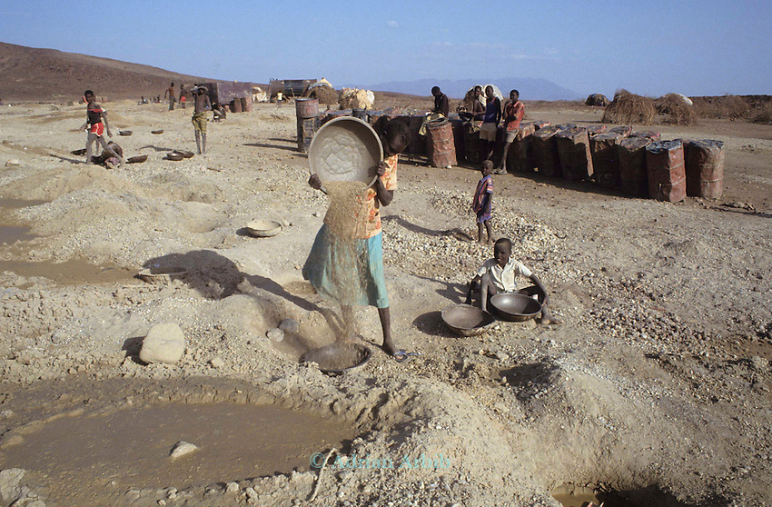 Gold mining (dry panning) on the plains of Northern Turkana. Children do much of the hard labour and panning