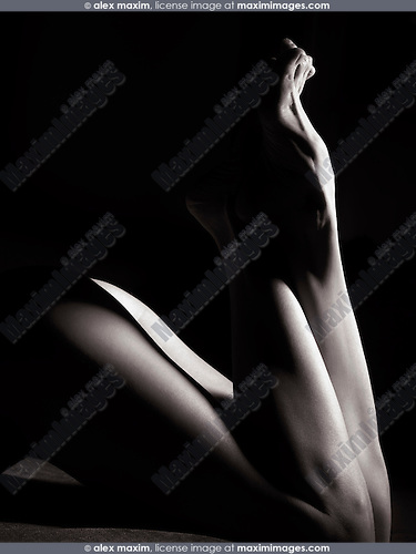 Abstract nude body closeup of crossed woman legs and feet black and white body parts fine art