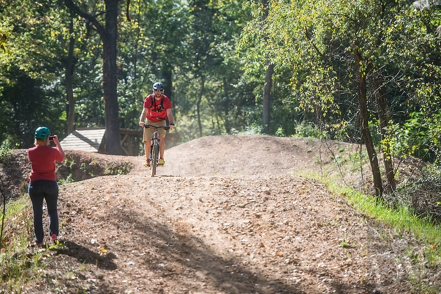 NWA Democrat-Gazette/ANTHONY REYES &bull; @NWATONYR<br /> A cyclist rides the downhill mountian bike course Tuesday, Oct. 6, 2015 on the trail system in Springdale. Groups gathered at the trailhead at Silent Grove Road and Pump Station Road in Springdale. The trailhead leads to the Razorback Greenway, J.B. Hunt park and a new mountain bike skills course and trail.