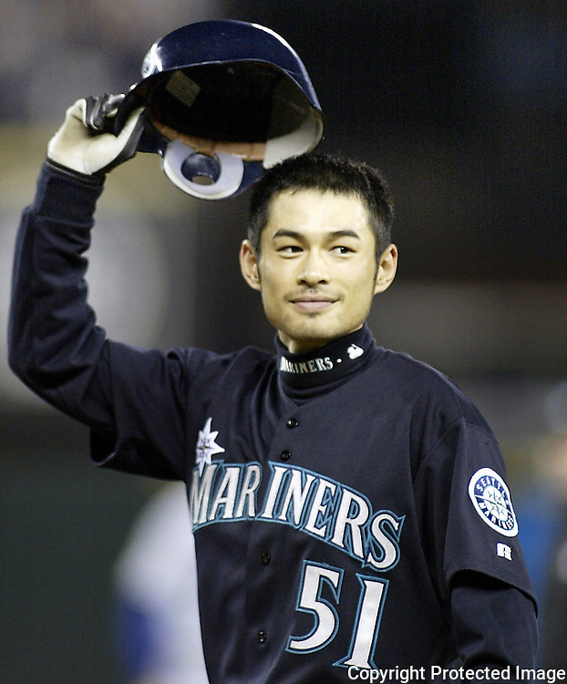 Seattle Mariners Ichiro Suzuki tips his hat to the fans after hitting a ball into center field which broke George Sisler's 1920 single season record of 257 in the third inning on Friday, Oct. 1, 2004 against the Texas Rangers at Safeco Field in Seattle.  Suzuki raised his single season hitting  total to 259. Jim Bryant Photo