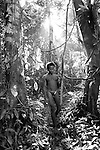 west papua, indonesia. kombai man out hunting in the forest, west papua, indonesia