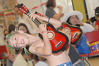 Jagger Nicholls, 6, plays the guitar to the music of Michael Cladis during the MLK Kidz Party at Virginia Avenue park on Saturday, January 15, 2011.
