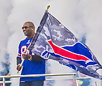 9 November 2014: Former Buffalo Bills Wide Receiver Eric Moulds waves a flag during pre-game activities prior to a game against the Kansas City Chiefs at Ralph Wilson Stadium in Orchard Park, NY. Moulds played twelve seasons in the National Football League (NFL), and college football for Mississippi State University. He was drafted by the Buffalo Bills in the first round of the 1996 Draft. The Chiefs rallied to defeat the Bills 17-13. Mandatory Credit: Ed Wolfstein Photo *** RAW (NEF) Image File Available ***
