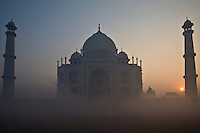 Dawn view of the Taj Mahal on a foggy winter morning. (Photo by Matt Considine - Images of Asia Collection)