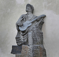 Statue of Karel Hasler, 1879-1941, Czech composer, playing a guitar and singing, by S Hanzik, Czech sculptor, at the bottom of the steps leading to Prague Castle, near the Wenceslas vineyard, Prague, Czech Republic. The historic centre of Prague was declared a UNESCO World Heritage Site in 1992. Picture by Manuel Cohen