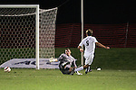 1 November 2006: Virginia's Adam Cristman (9) rolls a breakaway goal past Clemson goalkeeper Phil Marfuggi (left) to give Virginia a 2-0 lead in the 23rd minute. Virginia defeated Clemson 2-0 at the Maryland Soccerplex in Germantown, Maryland in an Atlantic Coast Conference college soccer tournament quarterfinal game.