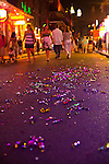 """After Madden Gras, colored ribbons line the ground of Bourbon Street in New Orleans's French Quarter.  EA Sports, creator of the popular """"Madden NFL"""" game, celebrates the release of the 2011 game edition with Madden Gras 2011, starring the New Orleans Saints.  Madden Gras 2011 culminates with a Mardi-Gras-style parade through the French Quarter of New Orleans to Jackson Square."""