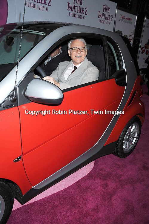 """Steve Martin in Smart Car..posing for photographers at The World Premiere of """"The Pink Panther 2 staring Steve Martin, Jean Reno, Emily Mortimer, Andy Garcia and Aishwarya Rai Bachchan on ..February 3, 2009 at The Ziegfeld Theatre in New York City. ....Robin Platzer, Twin Images"""
