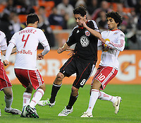 DC United midfielder Branko Boskovic (8)  goes against New York Red Bulls defender Rafael Marquez (4) and covering from behind midfielder Mehdi Ballouchy (10)      The New York Red Bulls defeated DC United 4-0, at RFK Stadium, Saturday April 21, 2011.
