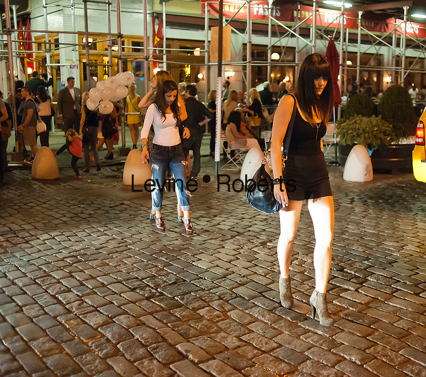 Hordes of shoppers descend on the trendy Meatpacking District in New York on Thursday, September 6, 2012 during the fourth annual Fashion's Night Out event. On the first evening of New York Fashion Week stores around the city offer sales and bargains as well as parties and events to entice customers to shop. The event has been so successful in boosting sales that over 100 cities in the US are having their own events, and Fashion's Night Out events occur in fashion-forward cities around the world. (© Richard B. Levine)