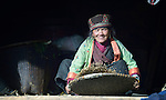 Pasang Bri Ghale winnows grain at her home in the Tamang village of Goljung, in the Rasuwa District of Nepal near the country's border with Tibet.