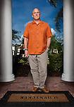 Parker Schenecker at thr front doorstep of his Tampa home