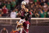 Mexico forward Aldo De Nigris (9) battles with Venezuelan defender Oswaldo Vizcarrondo (4). The national teams of Mexico and Venezuela played to a 1-1 draw in an International friendly match at  Qualcomm stadium in San Diego, California on  March 29, 2011...
