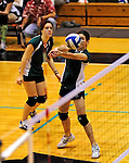 14 November 2010: Vermont Commons School Senior, and team co-captain Leynah McGarghan (left) watches teammate Lex Jackson hit during the 2010 Vermont State Volleyball Championships at Saint Michael's College in Colchester, Vermont. Participating schools included: the Enosburg Falls Hornets, the Lake Region Union Rangers, the Lyndon Institute Vikings, and the VCS Flying Turtles. The Girls Championship went to Vermont Commons School for the third consecutive year, while the Boys Championship went to Lake Region Union High School for the first time. Mandatory Credit: Ed Wolfstein Photo.