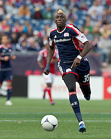 New England Revolution forward Saer Sene (39) brings the ball forward. In a Major League Soccer (MLS) match, the New England Revolution defeated Portland Timbers, 1-0, at Gillette Stadium on March 24, 2012