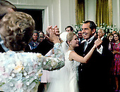 Washington, DC - June 12, 1971 -- United States President Richard M. Nixon dances with his daughter, Tricia Nixon Cox at the reception in the East Room of the White House in Washington, D.C. on Saturday, June 12, 1971 as first lady Pat Nixon and groom Edward Cox look on from left following the Rose Garden wedding.  More than 400 guests and family attended the happy affair..Credit: Pool via CNP