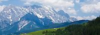 Green alpine hillside and distant peak of Hochkönig (2,941m) in the Northern limestone alps, Austria