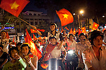 Vietnamese fill the streets of downtown Ho Chi Minh City celebrating the country's national soccer team's victory over Singapore at the SEA Games...Kevin German / LUCEO
