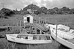 """""""They used [these skiffs] for mullet fishing, and they'd go to the banks for scalloping, oystering, things like that. Years ago they used to take 'em to kick clams. . . . People used to build them themselves.""""--Buster Salter, Atlantic fisherman"""