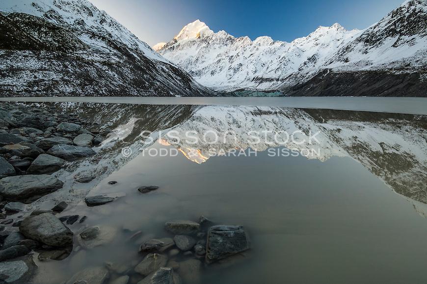 Aoraki Mt Cook & the Southern Alps reflected in Hooker Lake, late Autumn.  Aoraki Mt Cook National Park, NZ.