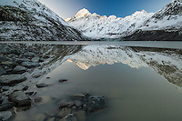 Aoraki Mt Cook & the Southern Alps reflected in Hooker Lake, late Autumn.  Aoraki Mt Cook National Park, NZ.