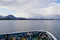 Bow of Hurtigruten traveling south along Norwegian coastline