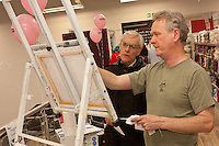 David Botham of Chesterfield listens to painter Tony Goldthrope