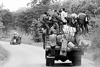 "Guinea. State of ""Guinée Forestière"". Guinean men on their way by truck to Kissidougou. Trucks and cars are usually loaded with people and goods. Daily life. © 2001 Didier Ruef"