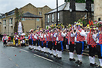 Uppermill, Saddleworth, Yorkshire Uk. Saddleworth Rushcart and Morris men leaving The Commercial pub.