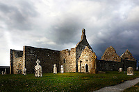 Low angle view of Clonmacnoise Cathedral, 10th century, from the south-east, and on the right Temple Doolin or Dowling, 10th century, restored 1689, and Temple Hurpan, 17th century,  Clonmacnoise, County Offaly, Ireland, in the evening. Clonmacnoise was founded by St Ciaran, with the help of Diarmait Ui Cerbaill, Ireland's first Christian King. Picture by Manuel Cohen