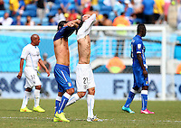 Andrea Pirlo of Italy and Edison Cavani of Uruguay remove their shirts at half time before swapping them