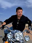 King Abdullah II of Jordan on his motorcycle in Wadi Rum