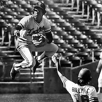 Minnesota Twins Rod Carew completes double play against the Oakland A's with Billy Conigliaro sliding. (1973 photo by Ron Riesterer)