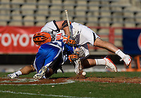 Chris LaPierre (44) of Virginia fights for the face off with Terrence Molinari (30) of Duke during the ACC men's lacrosse tournament semifinals in College Park, MD.  Virginia defeated Duke, 16-12.
