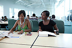 GABORONE, BOTSWANA - SEPTEMBER 22: Unidentified students study in the state of the art library at the University of Botswana on September 22, 2009 in the central business district in Gaborone, Botswana. Debswana, a 50/50 partnership between the De Beers Company and the government of Botswana has brought lots of revenues to Botswana, including an impressive infrastructure such as roads and free education up to university. Many students from poor families have the opportunity to got university if their grades are good. (Photo by Per-Anders Pettersson)....