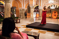 Australian violinist Niki Vasilakis plays the violin to a prominent audience, including the Princess Diya Kumari (left, foreground) of the Jaipur Royal Family, and other VIPs during a recital at the OzFest Gala Dinner in the Jaipur City Palace, in Rajasthan, India on 10 January 2013. Photo by Suzanne Lee