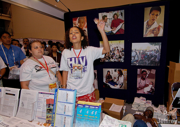 At the XV International AIDS Conference in Bangkok in 2004, young people took over the official U.S. government exhibit to demonstrate their views against U.S. AIDS policies and in favor of greater access to condoms for youth. On the right is Mandisa Mbali, a student at the University of Kwazulunatal in Durban, South Africa. Left is Kaytee Riek, a student at George Washington University in Washington, DC., USA.