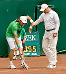 Nicolas Massu of Chile pulls the chair umpire, Magdi Somat over to check a line call during Massu's quarter final singles match with Sam Querrey of Australia at the US Men's Clay Court Championships at River Oaks Country Club in Houston, Friday, April 9, 2010. The umpire did not change the call. (AP Photo/Steve Campbell)    .