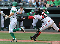 NWA Democrat-Gazette/ANDY SHUPE<br /> Harding Academy catcher Griffin Metheny (right) reaches to tag out Greenland pitcher Austin Anderson Friday, May 19, 2017, to complete the strike out during the Class 3A state championship game at Baum Stadium in Fayetteville. Visit nwadg.com/photos to see more photographs from the game.