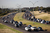 """Loop 1 is a controlled-access highway which provides access to the west side of Austin in the U.S. state of Texas. It is named Mopac Expressway (or, according to some highway signs, Mopac Boulevard) after the Missouri Pacific Railroad (or """"MoPac""""). The original section of the highway was built in the 1970s along the right-of-way of the Missouri Pacific Railroad (now owned by Union Pacific), with the railroad tracks running in the highway median between West 8th Street and Northland Drive. To the north, the tracks run along the east side of newer sections of the highway from Northland Drive to Braker Lane."""