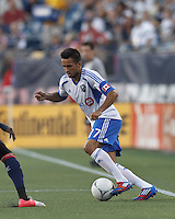 Montreal Impact defender Dennis Iapichino (17) dribbles at midfield. In a Major League Soccer (MLS) match, Montreal Impact defeated the New England Revolution, 1-0, at Gillette Stadium on August 12, 2012.