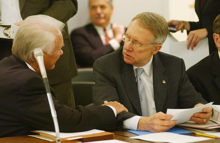 11/5/03.FISCAL 2004 APPROPRIATIONS: ENERGY AND WATER DEVELOPMENT--House Appropriations Chairman C.W. Bill Young, R-Fla., and Sen. Harry Reid, D-Nev., talk before the meeting of House and Senate conferees to consider legislation that would make fiscal 2004 appropriations for energy and water development programs. .CONGRESSIONAL QUARTERLY PHOTO BY SCOTT J. FERRELL