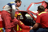 LEXINGTON, OH - JUNE 10: Gianpiero Moretti sits in the Alba/Momo AR3 001/Ford and co-driver Fulvio Ballabio stands alongside during a practice session for the Lumbermen's 500 IMSA GT race at the Mid-Ohio Sports Car Course near Lexington, Ohio, on June 10, 1984.