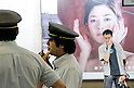 Tokyo, Japan - Train station workers talk amongst each other at Shinjuku station. Morning commuters typically spend over one hour on the train going to work. Trains are usually so packed that train platform staff have to push commuters to fit in the train so that the doors can close shut. (Photo by Yumeto Yamazaki/AFLO)